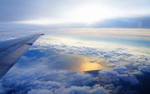 sky_altitude_clouds_airplane_wing_flying_soaring_48093_1920x1200